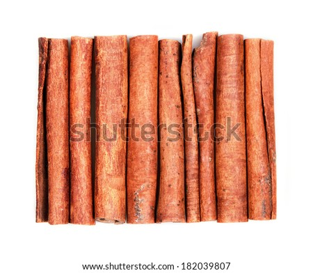 Aromatic cinnamon sticks on a white background