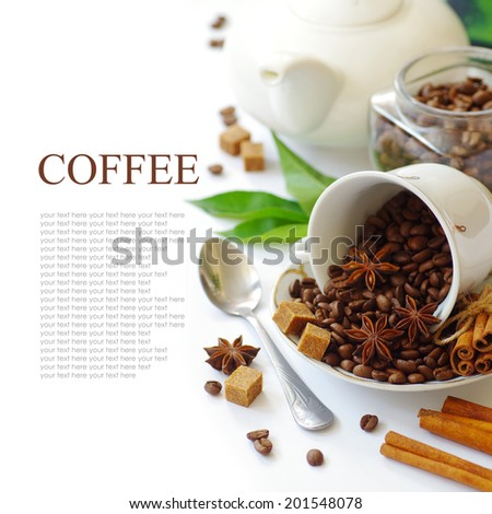 aromatic coffee beans and spices (star anise and cinnamon). isolated on white background. British tableware. - stock photo
