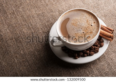 Aromatic coffee with roasted beans background - stock photo