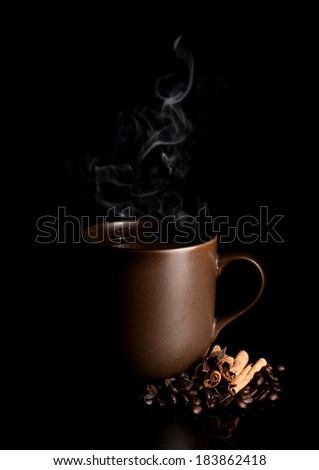 aromatic cup of coffee with smoke and beans