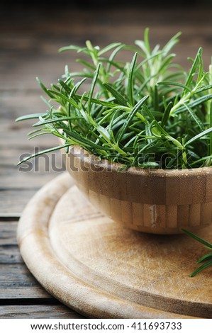 Aromatic fresh rosemary on the wooden table, selective focus