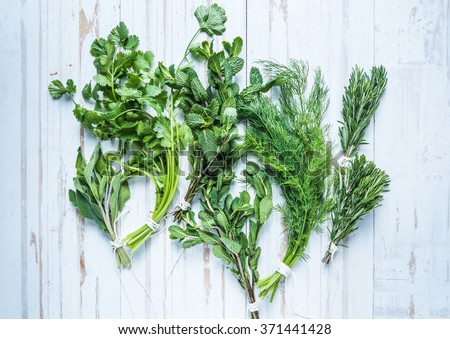 Aromatic herbs and spices from garden, healthy cooking concept, lay flat from above - stock photo