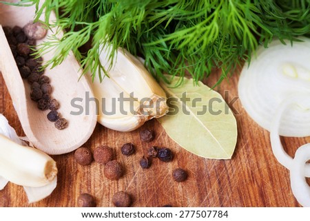 Aromatic herbs and spices on a table close-up