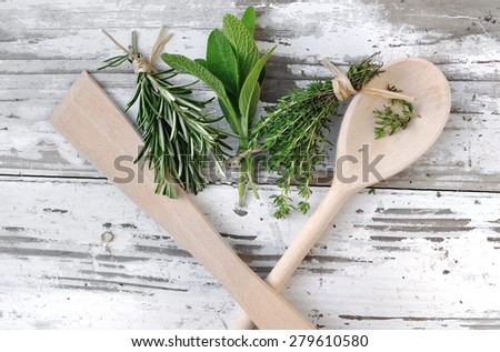aromatic herbs in bouquet  on white wooden with spoon  - stock photo