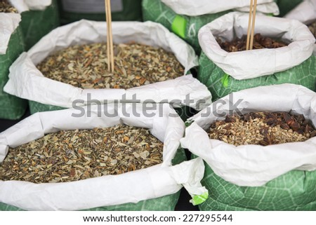 aromatic herbs in different bags with different smells - stock photo