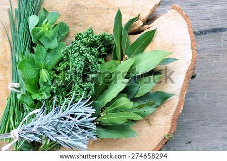 aromatic herbs on a wooden background - stock photo