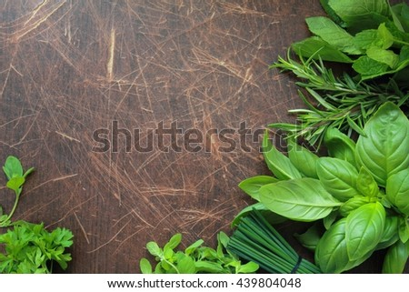Aromatic herbs on wooden background, fresh herbs from garden - stock photo