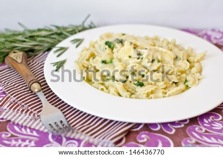 aromatic pasta with rosemary and baked cheese - stock photo