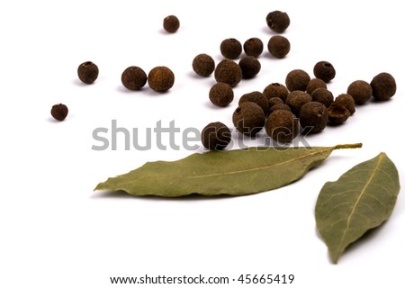 aromatic pepper and bay leaves on white background - stock photo