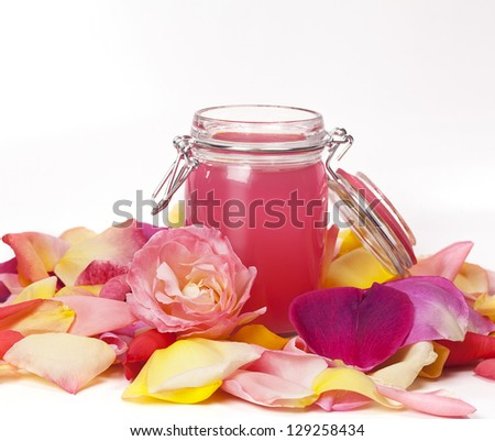 Aromatic rose water and petals. - stock photo