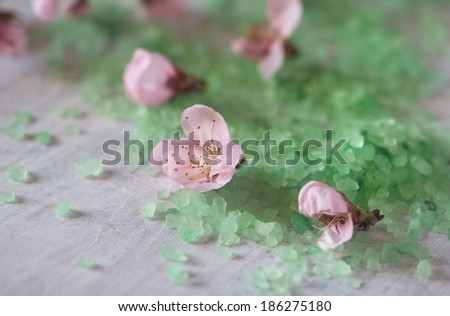 aromatic salt aqua water bath and flowers - stock photo