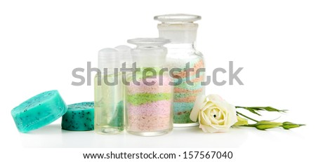 Aromatic salts in glass bottles, isolated on white - stock photo