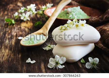 aromatic soap and salt on the old wooden background. aromatherapy spa concept