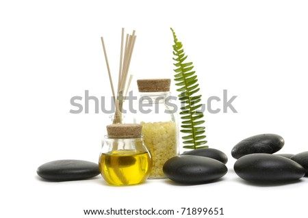 Aromatic spa set - reed diffuser and bottle of essential oil with green leaf - stock photo