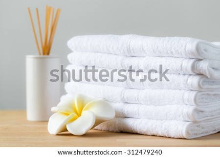 Aromatic spa with home diffuser and white towel - stock photo