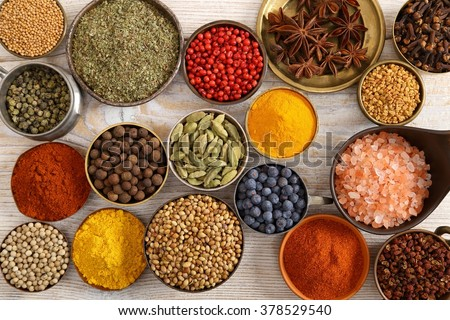 Aromatic spices in metal bowls. - stock photo
