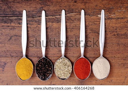 Aromatic spices on spoons.  - stock photo