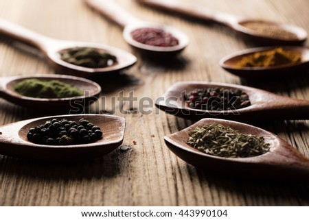 Aromatic spices on wooden spoons. Food ingredients. - stock photo