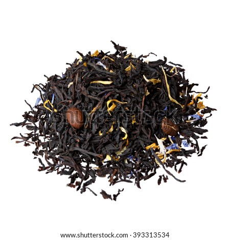 Aromatic tea with fruit, petals and coffee beans. - stock photo