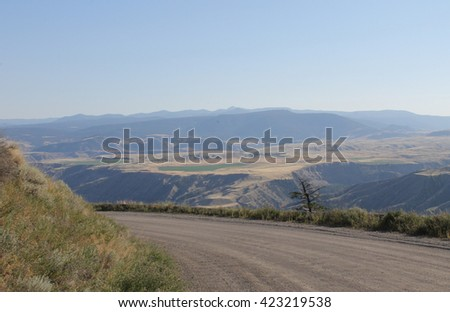 Around the bend  leading to the valley - stock photo