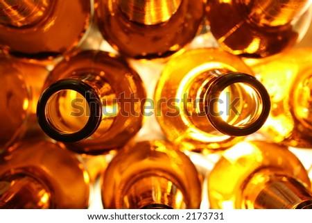 Arranged Beer Bottles Facing Necks - stock photo