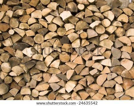 Arranged firewood pile. Wood logs stacked.