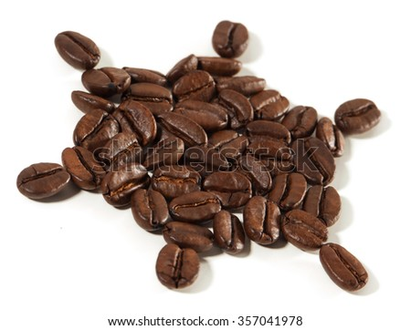 Arranged natural coffee beans isolated on white background. Soft focus view.. - stock photo