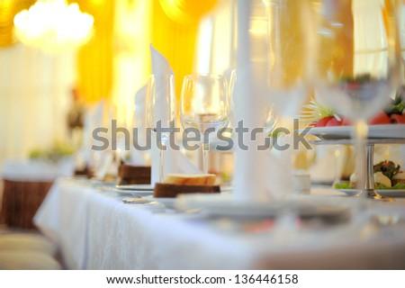 Arranged wedding table at restaurant - stock photo