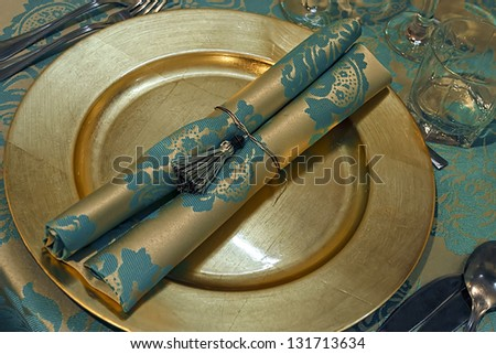 Arrangement for festive dinners with plates, tableware and ornaments. - stock photo