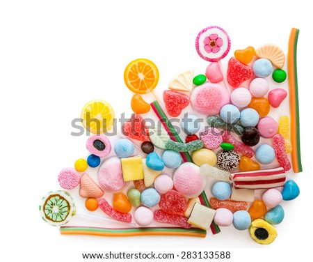 Arrangement of a variety of sweets on a white background - stock photo
