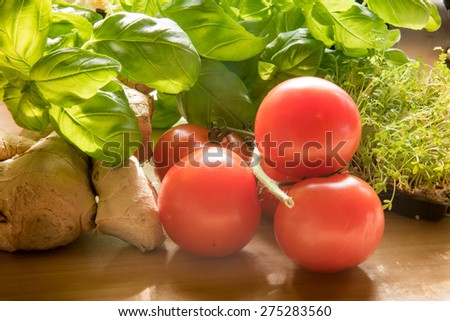 arrangement of basil, tomatoes and ginger