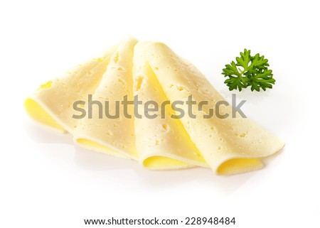 Arrangement of creamy Swiss cheese in thinly sliced folded squares with the tradional holes, or eyes, garnished with fresh parsley - stock photo