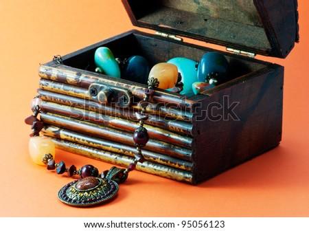 Arrangement of decorative casket with jewelry - stock photo