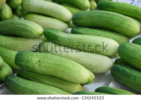arrangement of  fresh vegetables for sale in thailand local market pile of cucumber