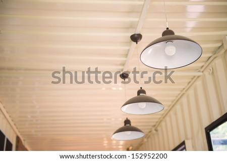 Arrangement of hanging lighting - stock photo