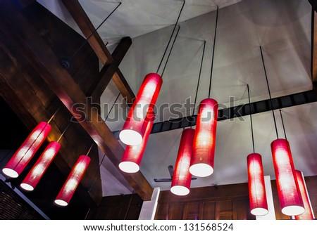 Arrangement of hanging lighting fixtures in Thai style - stock photo