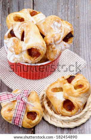 Arrangement of Homemade Pastry Baskets Jam Wrapped with Sugar Powder in Various Bowls closeup on Rustic Wooden background