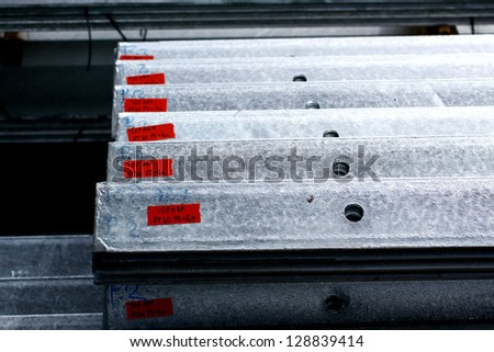 Arrangement of hot-dip galvanized steel angles in warehouse before shipment