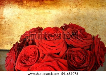 Arrangement of red blooming roses. Romantic bouquet with withering flowers for birthday gift, mothers day, valentines love present, wedding and bridal decoration. Image with old vintage filter effect.