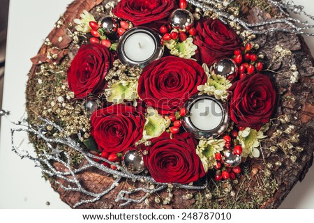 Arrangement of red roses bouquet with candle for christmas  - stock photo