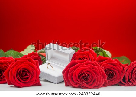 Arrangement of roses and golden ring at Valentine Day - stock photo