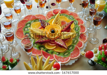 Arrangement of sliced fruits - stock photo
