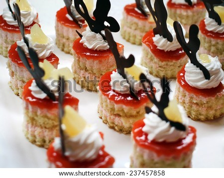 Arrangement of small desserts - stock photo