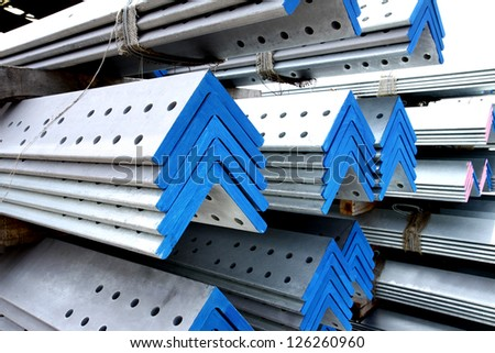 Arrangement of steel angles bunch in warehouse before shipment - stock photo