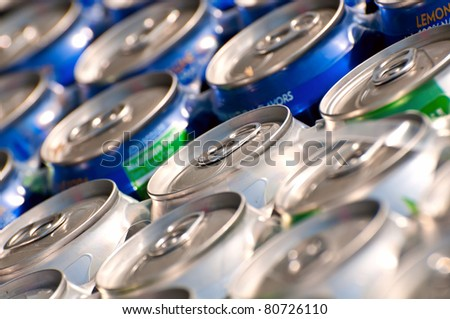 Arrangement of tins of soda. Shallow depth of field, focus on central ring pull. - stock photo
