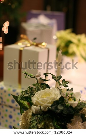 arrangement of wedding gifts with flowers and lights - stock photo