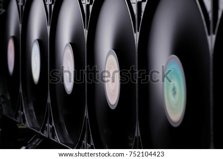 Array of CPU casing fans spinning fast. Selective focus.