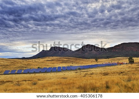 Array of on ground solar panels supplying electricity to Wilpena Pound in a middle of Flinders Ranges national park in isolation from power grid and infrastructure. - stock photo