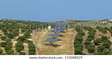 Array of solar panels in olive grove. Crete. Greece