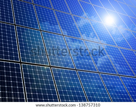 Array of solar panels with blue sky reflection